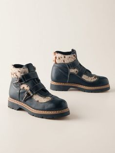Women's Alpine Hiker is a funky functional waterproof boot. These boots come in a vibrant red with animal print.