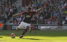 Manchester United's French striker Anthony Martial shoots to score their first goal during the English Premier League football match between Southampton and Manchester United at St Mary's Stadium in Southampton, southern England on September 20, 2015. AFP PHOTO / IAN KINGTONRESTRICTED TO EDITORIAL USE. No use with unauthorized audio, video, data, fixture lists, club/league logos or 'live' services. Online in-match use limited to 75 images, no video emulation. No use in betting, games or…