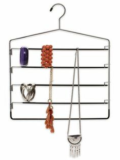 Look no farther than your closet for a jewelry organizer: a five-rung pants hanger makes a great holder for bracelets and necklaces. #spacesaver #organizationtips