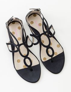 We imagine these sandals teamed with floaty skirts, blazing sunshine and foreign cities. Delicate circle detailing sets them apart from your go-to gladiators and a choice of simple colours makes them effortless to outfit. In soft leather, they're comfortable to wear whether you're navigating cobbled streets or sandy dunes.