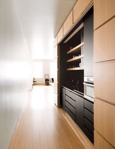 The Kitchen. Panels slide like trolleys along curving rails, stowing away in their siding or forming a seamless wall.