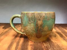 This rich and rustic cup is delicate yet solid, like it grew straight out of stone, weathered smooth and covered over with lichen around the rim.
