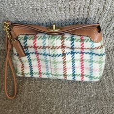 Coach WRISTLET Used coach WRISTLET in great condition except the mark I picture 4 . Coach Bags Clutches & Wristlets