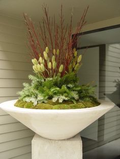Love Deborah Silver's interesting take on holiday materials. Fantastic moss in this container.