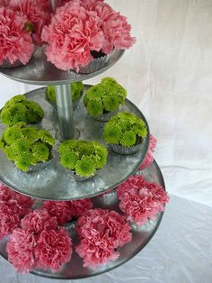 green button mums & pink carnations for inexpensive but pretty centerpieces