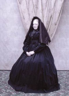 Older widow, heavy mourning veil.