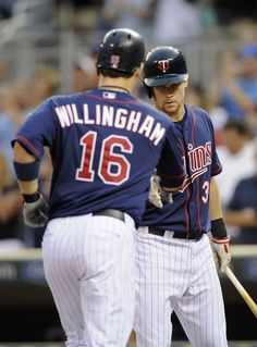 Justin Morneau #33 of the Minnesota Twins congratulates Josh Willingham #16 on a solo home run against the Baltimore Orioles during the fourth inning on July 18, 2012 at Target Field