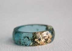 Size 9.5 aqua gold round eco resin ring. $25.00, via Etsy.