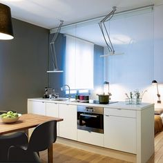 Glass window to separate the kitchen from the bedroom in a 35m2 Parisian flat : smart idea.