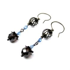 Items similar to Antique Brass Cage Dangle Earrings with Blue and Dark Amber Beads on Etsy Bird Jewelry, Jewelry Design, Brown Bird, Little Brown, Amber Beads, Antique Brass, Cage, Dangle Earrings, Dangles