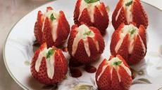 Strawberry Blossoms    For those of you who know me, this is the recipe for my famous stuffed strawberries.  I have more requests for this than anything else I make.  It's easy, looks elegant and simply delish.  This is the perfect season for them now....enjoy!