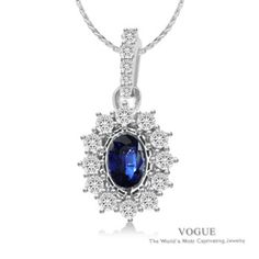 Stand out with this Riveting Oval Blue Sapphire Pendant with Radiating Diamond Halo set in 14k White Gold.