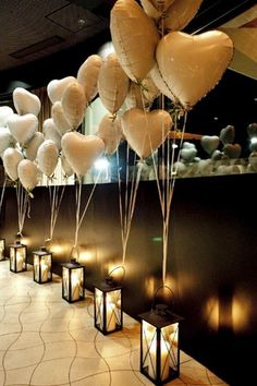Gorgeous gold balloons with lanterns. Great idea for wedding or party decorations at WaterVue Events.