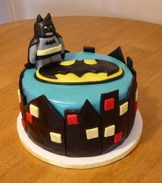 A 4th birthday party cake. His request was a Batman Lego cake :) I tried to make this look as cartoony and kid-like as possible! The Batman Lego figure is not the best, but he was at least present on the cake!    Black magic chocolate cake with vanilla buttercream icing, covered in marshmallow fondant and gumpaste accents. #food #recipe #halloween #thanksgiving #BlackMagicCake
