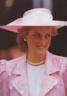 The Princess of Wales, wearing a pink and white Catherine Walker floral suit and matching Philip Somerville hat, inspects the guard of honour during a visit to Northampton to receive the Freedom of the City, June 8, 1989.