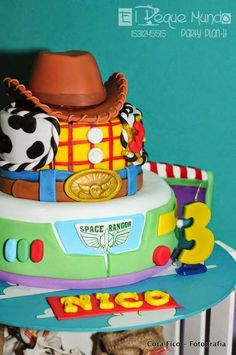 Woody and Buzz cake at a Toy Story birthday party! See more party planning ideas at CatchMyParty.com!