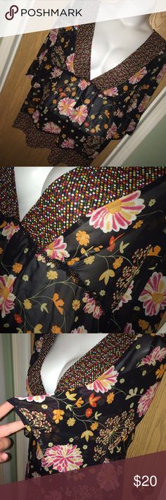 """Black & floral boho chiffon top Super pretty black and floral boho sheer chiffon top. It has a lace trim under the bust and around the hips. Deep plunge neckline. Good used condition. Size 22/24. 100% polyester. 25"""" from armpit to armpit, 20"""" from armpit to hem. Avenue Tops Blouses"""