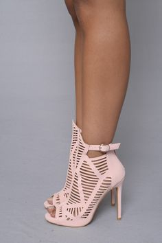 "- Available in black and pink - Caged Strappy - Ankle Strap with Buckle Closure - Zipper Back Closure - 4"" Heel - PU"