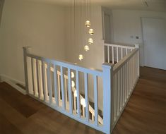 A quarter landing staircase with return balustrade. Manufactured in primed softwood, stop-chamfered spindles and slender newel caps are used to give a contemporary look. Glass Stairs, Metal Stairs, Painted Stairs, Wooden Stairs, Bespoke Staircases, Wooden Staircases, Curved Staircase, Staircase Design, Stair Spindles