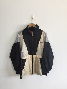 A personal favourite from my Etsy shop https://www.etsy.com/listing/469364362/vintage-nike-swoosh-hoodie-big-logo-warm