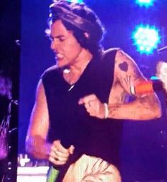 TATTOOS   Harry on stage in Buenos Aires, Argentina 5.3-4.14