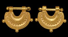 Greek Gold Lunate Pendant with Bar, 5th Century BCA gold crescent with ribbed loops to the horns, bands of filigree and granule detailing to both faces, granules to the outer edge, split securing pin.