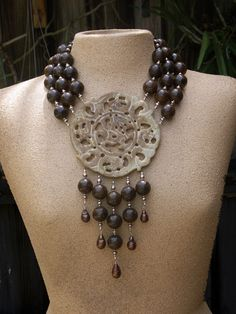 Necklace | Katie O Designs.  Carved jade pendant combined with bronzite and baroque bronze freshwater pearls.