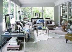to give the illusion you have carpeting Find a massive rug for layer one and put a smaller area rug on top. This gives the illusion that you're placing a rug over carpeting (but it's cheaper than actually installing carpet!).
