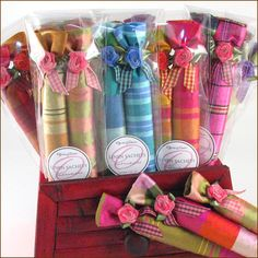 French lavender linen sachets, Lavender stick sachets. These sachets are the perfect touch for any closet or drawer. Filled with French lavender, each is lovingly detailed with an organza rosette and colorful gingham ribbon.