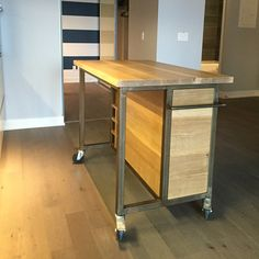 White oak island cart designed and made by us for a condo size kitchen.