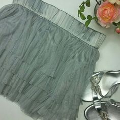 Darling silvery gray short skirt 4 layers of gray netting over the nice lining. Elastic waistband for comfort. Divided Skirts Mini