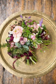 Lush pink, purple and green bridal bouquet