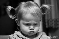 pouting in pigtails. Every parent should have at least one photo of their child pouting. Too cute.