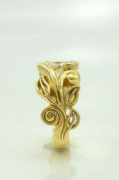 Side view of leaf motif engagement ring.