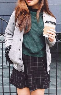 Grey varsity jacket, forest green sweater and grid skirt