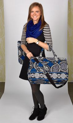 Nissa carries ... the Frame Travel Bag and Vera in Canterberry Cobalt.