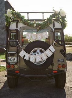 Land Rover Defender, decorated for wedding getaway car by Broadturn Farm. Photo by Meredith Perdue