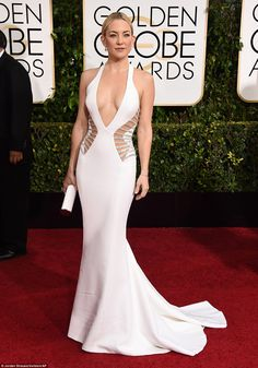 Pale but VERY interesting! Kate Hudson wowed in white cut-out Versace as she arrived for the Golden Globes in Los Angeles on Sunday