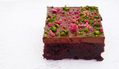 bad brownie - brownie filled with raspberry jam filling and a milk chocolate ganache topped with pistachios and crystallised rose petals