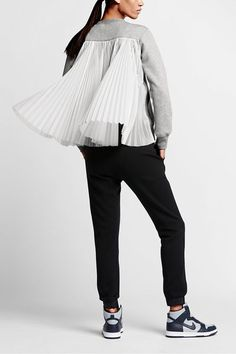 Because who doesn't look pretty in pleats?Nikelab x Sacai Tech Fleece Pleated Back, $325, available at Nike....