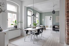 The green-grey color of the living room wall in this apartment is such an eye-catcher. I like that the same color comes back in the pillows in the bedroom as well. The kitchen has a very simple design, yet the … Continue reading → Retro Dining Chairs, Blue Dining Room Chairs, Dining Table, Dining Rooms, Light Gray Cabinets, Green Cabinets, Nordic Interior, Kitchen Interior, Interior Design