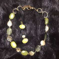 Sigrid Olsen jade and gold tone necklace/ratings Sigrid Olsen necklace and earring set. Genuine stone (Quartz and Jade?) Gold tone metal. Fine quality. Not new but gently worn only a couple of times. Sigrid Olsen Jewelry Necklaces
