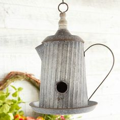 The unique detailing and vintage inspired charm of this Decorative Metal Pitcher Bird House will bring a touch of nature to your decor. Visit Antique Farmhouse for more decorative bird houses. Bird Houses Painted, Decorative Bird Houses, Bird Houses Diy, Decorative Metal, Painted Birdhouses, Bird House Plans, Bird House Kits, Traditional Birdhouses, Homemade Bird Houses