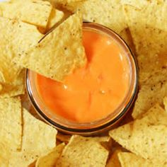 Nachos and sauce. Nachos and cheese sauce close-up view from above , Taco Bell Cheese Sauce Recipe, Homemade Nacho Cheese Recipe, Homemade Nachos, Nacho Cheese Sauce, Taco Bell Nacho Cheese, Dip Recipes, Cheese Recipes, Sauce Recipes, Mexican Food Recipes