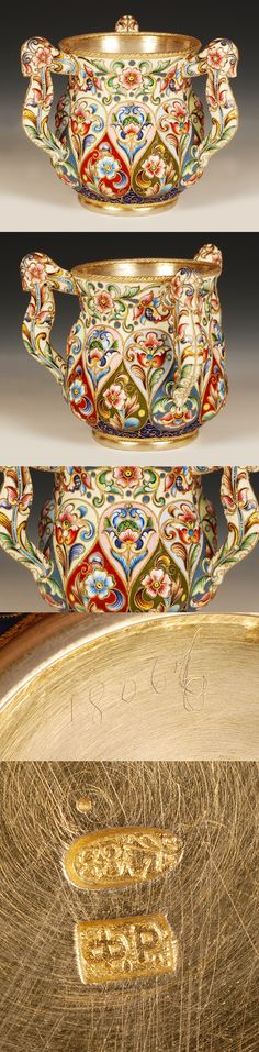 A Russian silver gilt and shaded cloisonne enamel three handle cup, Feodor Ruckert, Moscow, circa 1896-1908. Baluster form, the lower section with lobed cartouches enameled wit hgriffins and stylized floral and foliate sprays on red, blue and olive grounds, the upper section enameledd with flower-heads and stylized floral and foliate sprays on a cream ground. The handles decorated with similar decoration.