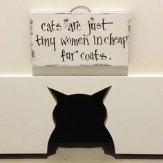 """we have a cat hole in the laundry room door, so the cats can go in and out but we needed a sign...."" --original pinner"