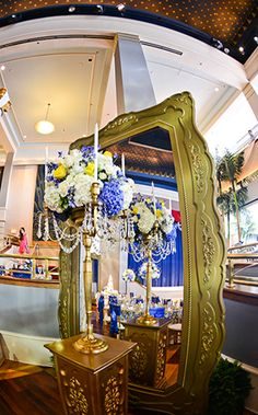 Add a touch of elegance to your reception with floral candelabras or a decadent gold mirror- or both! #wedding #reception