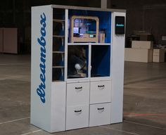 Dreambox, is a 3D printing vending machine that provides easy access to rapid manufacturing without the hassles of owning and operating a 3D printer. The machine is fully automated: users upload their design at the Dreambox website or at a Dreambox machine, the design is sent to the nearest vending machine, and once the object is printed it is stored in a locker until pickup. The machine is available 24/7 and prints have a same day turnaround time. The Dreambox team is based in Berkeley, CA.