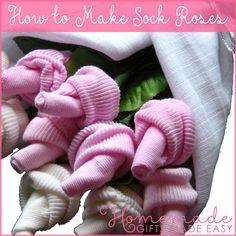 Baby sok roosjes op een zelfgemaakte luiertaart. Versier je eigen luiertaart met bloemen die jezelfmaakt van een slabbe, baby sokjes, mutsje,