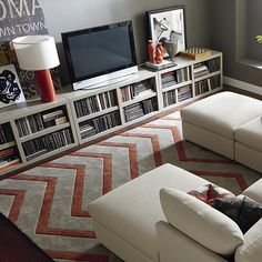 Entertainment Console. I like the idea of lining up storage pieces to bring unity to the space.